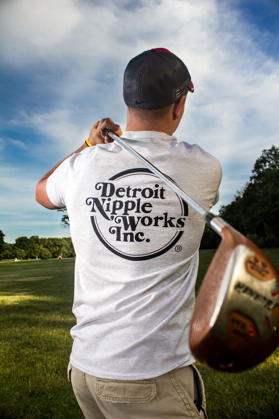 Detroit Nipple Works Back of Gray Shirt